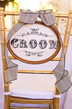 Fancy wedding chair with free Wedding Chicks printable Groom Sign.  http://www.weddingchicks.com/freebies/wedding-signs-labels/custom-bride-and-groom-signs/
