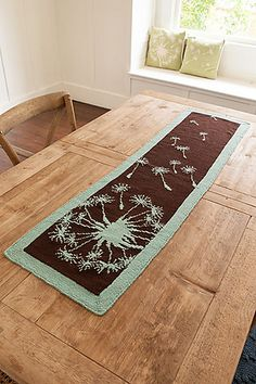 Ravelry: Dandelion Runner pattern by Kerin Dimeler-Laurence  Cool knit table runner!