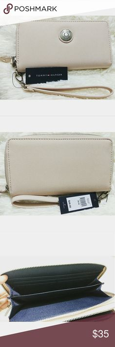 NWT TOMMY HILFIGER WRISTLET Brand new with price tag Color: nude Two compartments.  Big enough to hold your phone, credit cards or money. Tommy Hilfiger Bags Clutches & Wristlets