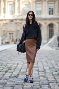 cu-out shoulder crop top, brown leather skirt & sneakers #style #fashion #streetstyle #modeloffduty