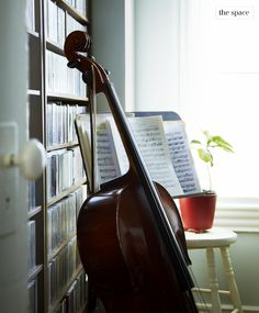 Lovely - there's something about musical instruments sitting out with sheet music like this, as though someone was just playing it (only in homes where they're actually played, though, otherwise it's pretentious).
