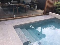 Hide your pool cover under ground, out-of-sight when not in use. The Aussie UnderCover® is the only truly hidden pool cover system that can be tiled! Swimming Pool Tiles, Swimming Pool Landscaping, Pool Decks, Pool Cover Roller, Underground Pool, Mdf Furniture, Hidden Pool, Piscina Interior, Aluminum Decking