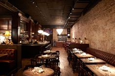The dining room has a great vibe with leather booths, dark wood and exposed brick