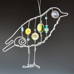 Wire Bird - I'm inspired, but don't know how to make a big one of these, and have it be a collaborative project to put buttons, beads, paper beads? onto the vertical wire/strings. Hmmm. Once I figure it out, we'll try it.
