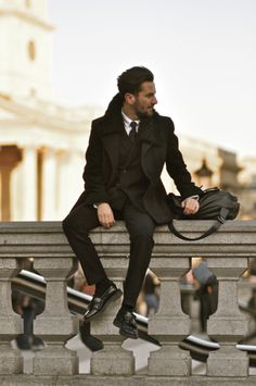 black peacoat fur collar, black jacket, white shirt, black quilted tie, black socks, black shoes