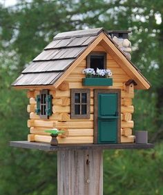 Create a rustic retreat for birds in your backyard using the Home Bazaar Country Comfort Bird House. This quaint piece adds a focal point to your yard in moments, with its log cabin-inspired siding, realistic architecture, and natural color scheme.  The wooden construction creates a sturdy home, and its natural finish meshes with your backyard trees. Offer birds a cozy roost with this Country Comfort Bird House. - JacobsOutdoor