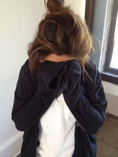 messy bun and oversized clothing