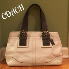 "EUC Coach Soho Carryall...Large!!! This is a fabulous all leather, Ivory w/ Chocolate Brown trim Coach Soho Carryall Zippered Satchel / Shoulder bag !!!  Extra large my laptop can fit inside!!!  In superb condition. Soft, supple leather. Full width outer deep pocket w/magnetic closure, adjustable dual shoulder straps w/ 8""-10"" drop, hang tag, gussets snaps for room expansion, bright nickel hardware, zip closure. Interior mint condition. Zip pocket, 3 slip pockets. Measures 16""x10""x7"" Coach…"