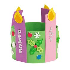Think I could make something similar out of construction paper. Advent Candle Stand-Up Wreath - OrientalTrading.com