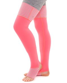 Fold the Roll With It Legwarmers over your feet to avoid floor burn while you work on your triple.