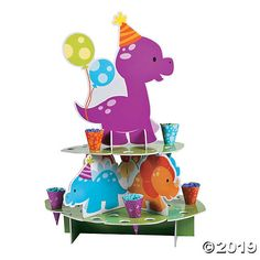Planning a Little Dino birthday party? What's your plan for party treats? Check out this treat stand! Fill the paper cones with snacks and place in the ...