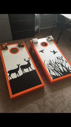 Hand painted deer and duck cornhole boards with matching orange and white camo bags