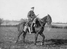 A corporal of 'C' Squadron, The Queens Bays, riding a captured German horse. This animal was ridden back from Nery by Major Harman after he was wounded on 1 September 1914. The horse was then taken onto the strength of the Squadron.