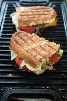 Grilled Vegetable Panini loaded with zucchini, roasted bell peppers and red onion. Topped with slices of mozzarella cheese and grilled until toasted and melted.