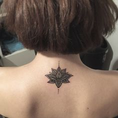Small lotus mandala tattoo on back: