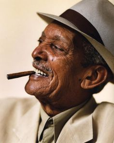 Compay Segundo (born Máximo Francisco Repilado Muñoz), Cuban trova guitarist, singer, composer, inventor of the armónico & member of Los Compadres, one of the most successful Cuban duos of its time. He gained greater international fame with the releases of the album & film Buena Vista Social Club. His most famous composition is Chan Chan, whose opening chords are instantly recognizable worldwide. He was called Compay Segundo because he was always second voice in his musical partnerships…