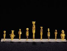 Nine gold gods  The gods depicted in these sculptures are Uraeus (cobra), Bes, Ptah, Sobek, Isis, Hathor, Amun, Ptah, and Patek.  New Kingdom to Ptolemaic Period, 1500–30 BCE Gold The Egyptian Museum, Cairo