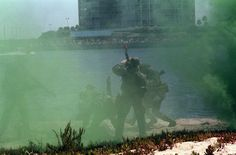 DN-SC-93-05930  Smoke surrounds members of a U.S. Navy Sea-Air-Land (SEAL) team as they participate in a public demonstration.