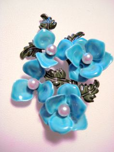 Awesome Shabby Chic Pearl Vintage Blue and Green Enamel Metal Flower Pin. $18.95, via Etsy.