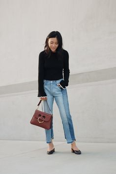 J.W. ANDERSON Bag / ZARA Top (Similar here) / FRAME DENIM Jeans / MARI  GIUDICELLI Shoes / LOW CLASSIC Trench coat   New favorite mules from Mari, breaking in not necessary.  JavaScript is currently disabled in this browser. Reactivate it to view  this content.