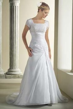 Classic modest wedding dress.  I like the pinched fabric at the top of the skirt.