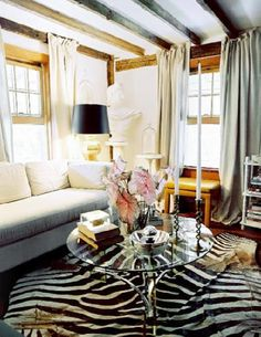 Lonny Magazine - living rooms - Eddie, Ross, zebra, rug, farmhouse, rustic, glamour, modern, seafoam, green, silk, drapes, white, sofa, glass, coffee, table, exposed, wood beams,