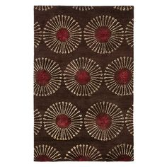 Featuring a starburst motif in coffee and brown, this hand-tufted wool rug adds a pop of pattern to your living room or master suite.