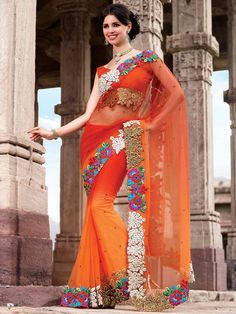 Enhance your style statement with this orange-red nett saree. This is a fancy saree designed for any parties. The most attractive part of the saree is it gorgeous multi colored border.  The minute buties on it gives it a stunning look. (Slight variation in color is possible)