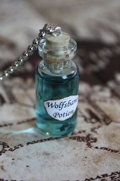 Harry Potter Potion Wolfsbane Vial Necklace by spacepearls. , via Etsy. $17.00 but I think I could make it for less