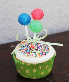 Balloon Bunch Cupcake Toppers: This edible topper is easy to pull together (and fun to eat!). Simply tie a ribbon around a few lollipops, stick the bouquet in the middle of the cake, and dust the frosting with colorful sprinkles to transform a plainly frosted cake into a festive birthday centerpiece.