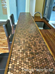 Counter top with pennies. we're so rich, we use money to eat off of. jk...i could definitely do this with my penny collection though.