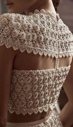 Did you know that the back of your outfit can also be the showstopper? Enter, bejewelled outfit backs! We are spotting a ton of brides and designers coming up with outfit back designed with jewellery. Indian Gowns Dresses, Indian Fashion Dresses, Dress Indian Style, Fashion Outfits, Indian Wedding Outfits, Bridal Outfits, Indian Outfits, Fancy Dress Design, Crochet Clothes