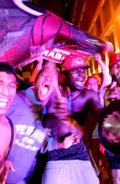JUNE 20: Fans celebrate in the streets after the Miami Heat won the NBA title against the San Antonio Spurs on June 20, 2013 in Miami, Florida. The Heat have won back to back championships.