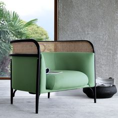 Danish design duo GamFratesi has incorporated cane panels into a collection of steam-bent furniture for Viennese furniture manufacturer Gebrüder Thonet