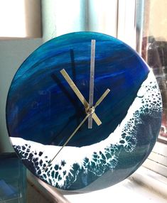 Hand painted with acrylics and resin, this beautiful clock brings drama and interest to your wall with a crisp wave crashing over a gradient of green hues. The clock is made on a wood base that is 9 inches in diameter. Diy Resin Crafts, Decor Crafts, Crafts To Make, Wall Clock Wooden, Clock Wall, Clocks Inspiration, Cool Wall Decor, Indoor Crafts, Clock Painting