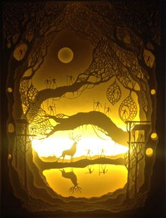 Utopia by hari and deepti. Paper cut shadow box cut and assembled in a wooden box to create a diorama, incorporating back-lit light boxes using flexible LED strip lights.