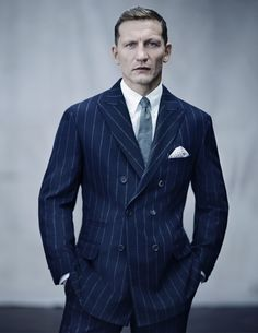 Double-breasted peak-lapel sport coat in navy pinstripe wool/cashmere. Flat-front pants in navy pinstripe wool/cashmere. Tie in solid gray wool flannel. Sharp Dressed Man, Well Dressed Men, Blazers, 1920s Suits, Terno Slim, Cashmere Suit, Pinstripe Suit, Black Dress Shoes, Sartorialist