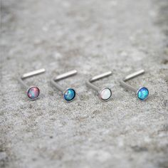 """Our brand new opal surgical steel """"L"""" shape Nose Stud Rings from Hollywood Body Jewelry Piercing Jewelry"""