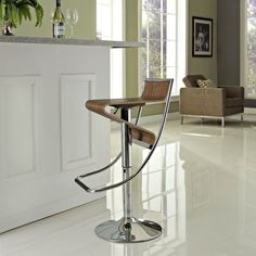 Big style without trying, our barbershop bar stool is sexy, stylized and provocative. Form meets function as you easily swivel away from the table or use hydraulics to adjust from table to bar height. Walnut plywood seat and sturdy steel frame with footrest add visual pop to your mid-century modern dining space.