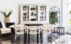 A fresh and vibrant take on plantation style. Make every dining experience one to remember, with Brass Handles, Old World Charm, Dining Room Design, Engineered Wood, Bon Appetit, Cupboard, Dining Table, Shelves, Interior Design