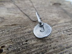 Personalized initial necklace in recycled sterling silver with a torch pinned bail by JoDeneMoneuseJewelry on Etsy