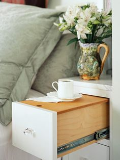 side table or night stand ...perfect place to sit your drink.