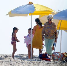 Katie Holmes at the beach in a crochet-topped sundress