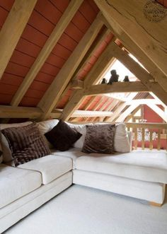 Snug area above barnroom with terracotta painted timber ceiling boards on green oak frame