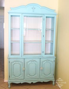 Love this turquoise hutch! #DIY