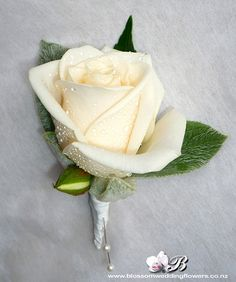 cream-rose-buttonhole by Blossom Wedding Flowers, via Flickr