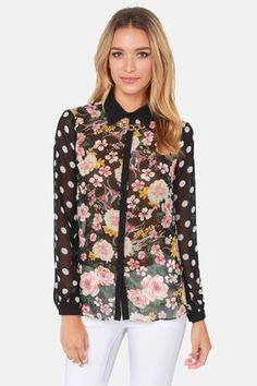Check it out from Lulus.com! Mixing patterns is all the rage, so stay on trend with the Mix It Up Black Floral Print Button-Up Top! Black Georgette boasts a pink, yellow, and green floral print bodice, while billowy long sleeves with button cuffs are pretty in ivory polka dots. A hidden button placket and classic collar keep it chic in solid black. Unlined and slightly sheer. Model is wearing a size small. 100% Polyester. Dry Clean Only. Imported.