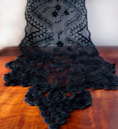 Add this intricate black lace table runner to burlap and linen tablecloths to create a beautiful starting point for vintage inspired table settings. #lace #tablerunner #vintage