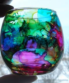 Faux Stained Glass : I cleaned the glass off first with rubbing alcohol. Then I added a drop or two of alcohol ink at a time and then sprooshed it with the canned air. Sooooo cool. Do not use near heat..toxic fumes may occur