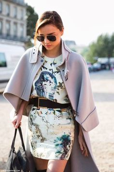 graphic printed dresses and a sleek capes.